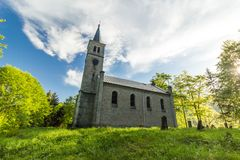Beautiful old church and cemetery in the wood Royalty Free Stock Photo