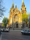Beautiful, old church in the Gothic style, near the city street stock photo