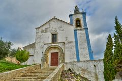 Old church in Torres Vedras, Portugal. Beautiful old church on a hill in Torres Vedras, Portugal Royalty Free Stock Image
