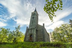 Beautiful old church and in the trees Stock Photo