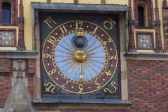 Beautiful old clock on the wall of the city hall, wroclaw, polan Stock Images