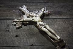 Beautiful old cross with jesus on the old wooden floor. Beautiful old cross. with jesus on the old wooden floor Royalty Free Stock Photo