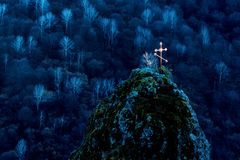 Beautiful old cross in mountain burial. Beautiful view of burial in mountains with cross Stock Photos