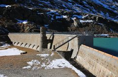 Beautiful old dam of Lake Blanc, Bernina pass stock photo