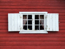 Beautiful old decorative window. Old windows with white shutters. Typical Norwegian architecture Royalty Free Stock Photography