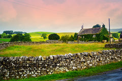 Beautiful, old English cottage with stone walls Stock Image