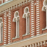 Beautiful old facade with windows. Beautiful windows of an ancient brick palace Stock Photography