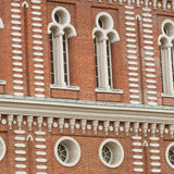 Beautiful old facade with windows. Beautiful windows of an ancient brick palace Royalty Free Stock Photography