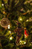Beautiful retro christmas toy of prince frog and lights background on christmas tree Stock Images