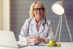 Beautiful old female doctor Stock Photography