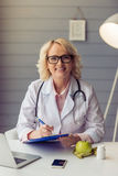 Beautiful old female doctor Stock Image