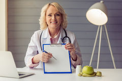 Beautiful old female doctor Stock Images