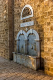 Beautiful old fountain in Jaffa with hebrew inscription Royalty Free Stock Photography