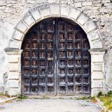 Beautiful old gate on the stone wall background. Close-up. Architecture. royalty free stock photo
