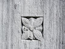 Old wooden surface  with flower ornaments Stock Photos