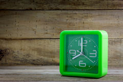 Beautiful old green clock on wood background. Royalty Free Stock Images