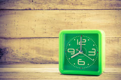 Beautiful old green clock on wood background. Royalty Free Stock Photography