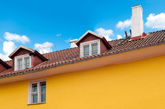 Beautiful old house with cloudy sky in background Stock Photos