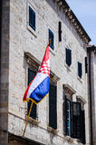 Beautiful old house with the croatian flag on the main walking street in the old town of Dubrovnik Royalty Free Stock Photo