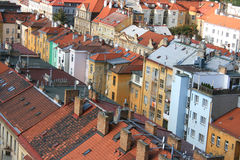 Beautiful old houses in Prague. View of the tiled roofs of old Prague. Beautiful, bright and old houses Stock Image