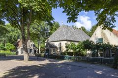 Beautiful old houses on a small square in the place Nes on the island Ameland.  stock photo