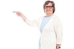 Beautiful old lady pointing away Royalty Free Stock Photography