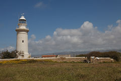 Beautiful old lighthouse in Paphos Archaeological Park. Cyprus Stock Photos