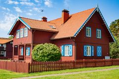 Big red wooden house. Beautiful old Lithuanian traditional wooden red house in Nida, Lithuania, Europe stock images