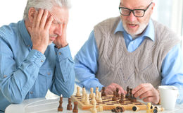 Beautiful old men play chess Royalty Free Stock Photography
