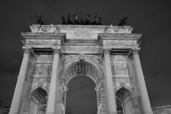 Napoleon monument arch of peace. View from the bottom of the `Arco della Pace` monument in the night. Black and white picture royalty free stock images