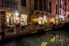Beautiful old narrow street at night in Venice. The beautiful old narrow street at night in Venice, Italy. The traditional street in Venice is a canal Stock Images