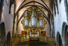 Beautiful old organ decorated by gold Stock Photos