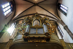 Beautiful old organ decorated by gold Royalty Free Stock Image