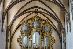 Beautiful old organ decorated by gold Royalty Free Stock Images
