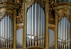Beautiful old organ decorated by gold Royalty Free Stock Photo