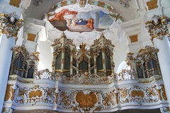 Beautiful old organ inside White church Beieren Germany royalty free stock photography