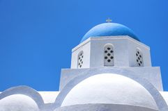 Beautiful old orthodox white church with blue dome against the blue sky, Oia, Santorini, Greece, Europe. Classic white Greek. Architecture, houses, churches stock image