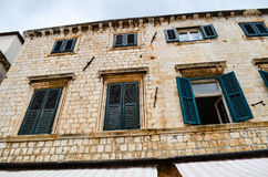Beautiful old palace  with tipical windows in the  street in the old town of Dubrovnik Royalty Free Stock Photos