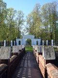Path and old park gate in Sveksna park, Lithuania Royalty Free Stock Photography
