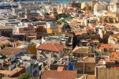 Beautiful old place in Alicante city, Santa Cruz. Alicante, Spain, May 2018. Rooftops and the sea. Alicante, Spain, May 2018: Beautiful place in Alicante city Stock Image