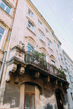 Beautiful old retro balcony  with flowers in the vintage house, Lviv, Ukraine Stock Photos