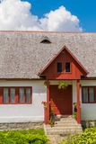 Beautiful old romanian traditional house with wood tiles roof, front entrance porch, flowers and windows. Beautiful old romanian traditional house with wood stock photography