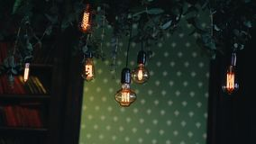 Beautiful old school incandescent lamps decorate the room. Objects stylized antique. Beautiful thing stock video