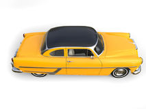 Beautiful old school yellow car with black roof - top down side view Stock Photos