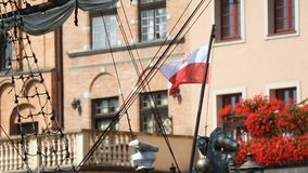 Beautiful old ship with flag of Poland sailing near embankment in Gdansk. Stock footage stock video