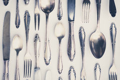 Beautiful old silver cutlery - vintage style filter Royalty Free Stock Photos