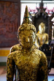 Beautiful old standing buddha image statue covered by gold leaf, Royalty Free Stock Photos