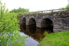 Beautiful old stone bridge. Old stone bridge with three tunnels Royalty Free Stock Image
