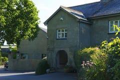 Twelve Oaks Farmhouse. Beautiful old stone farmhouse graces the entrance to Twelve Oaks Royalty Free Stock Photo