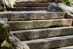 Beautiful old stone stairs natural stone steps in summer park Royalty Free Stock Images